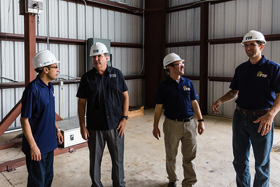 From left to right: Bodhisatta Hajra, Research Scientist, Erik Salna, Associate Director, Raphael Greenbaum, Research Specialist, Jimmy Erwin, Research Scientist talk in the Wall of Wind building after the first hurricane-force wind test at the FIU Engineering Center in Miami Dade on Wednesday, July 27, 2016. FIU hosted a demonstration to show the impact of hurricane-force winds on a scaled down model home. (Joseph Forzano / The Palm Beach Post)
