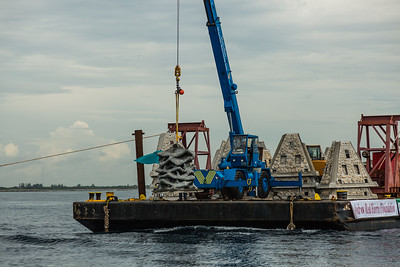 One hundred artificial reef modules are being lowered from a barge to the sea bed off the coast of Jupiter, Florida, on Monday, August 8, 2016 (Joseph Forzano / The Palm Beach Post)