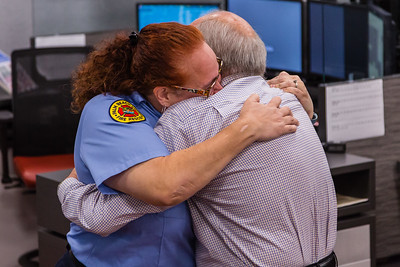 Dispatcher Melissa Behn and Bob Stephens hug after meeting for the first time on Thursday, August 25, 2016 at the Palm Beach County Dispatch Center in West Palm Beach. Stephens called 911 when his wife Carrie started hemorraging in their home in Boca Raton on January 15, 2016 and Behn talked him through slowing the bleeding until Palm Beach County Fire Rescue could arrive to take her to the hospital where she received a transfusion which saved her life. (Joseph Forzano / The Palm Beach Post)