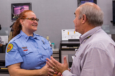 Dispatcher Melissa Behn and Bob Stephens talk after meeting for the first time on Thursday, August 25, 2016 at the Palm Beach County Dispatch Center in West Palm Beach. Stephens called 911 when his wife Carrie started hemorraging in their home in Boca Raton on January 15, 2016 and Behn talked him through slowing the bleeding until Palm Beach County Fire Rescue could arrive to take her to the hospital where she received a transfusion which saved her life. (Joseph Forzano / The Palm Beach Post)