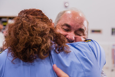 Dispatcher Melissa Behn and Bob Stephens hug after meeting for the first time on Thursday, August 25, 2016 at the Palm Beach County Dispatch Center in West Palm Beach. Stephens called 911 when his wife Carrie started hemorraging on January 15, 2016 and Behn talked him through slowing the bleeding until Palm Beach County Fire Rescue could arrive to take her to the hospital where she received a transfusion which saved her life. (Joseph Forzano / The Palm Beach Post)