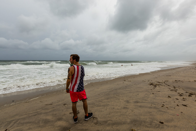 Colton Lewis of Delray Beach watches the waves formed by Hurricane Matthew crash on Delray Beach on Thursday, October 6, 2016. (Joseph Forzano / The Palm Beach Post)