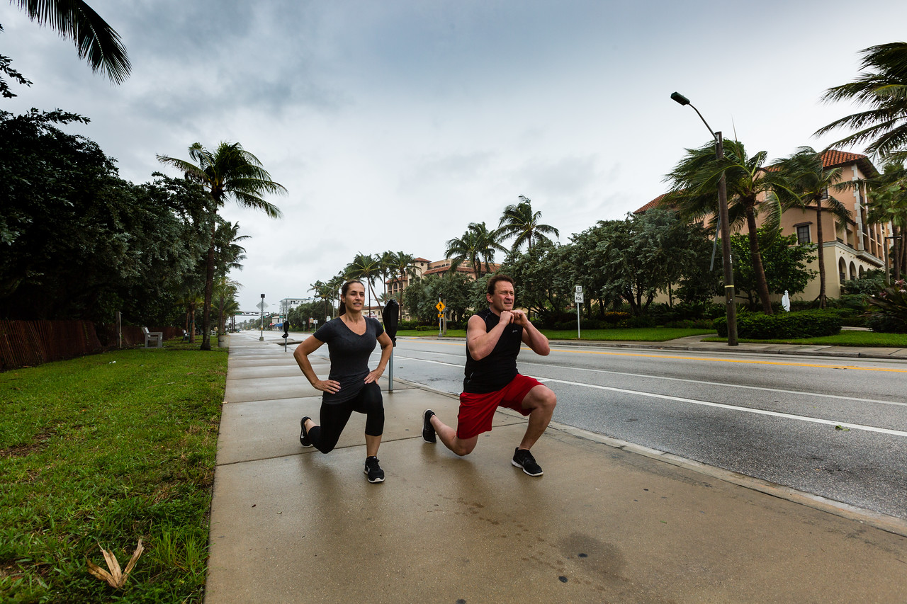 Gina Lorenzo and Eric Hermann  of Delray Beach get in their daily excercise along A1A in Delray Beach on Thursday, October 6, 2016,  as Hurricane Matthew approaches the South Florida coast. (Joseph Forzano / The Palm Beach Post)