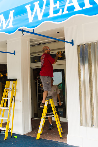 Pat Lena and Frank Capano install the last of the hurricane shutters on South Beach Shop storefront along A1A in Delray Beach in preparation for Hurricane Matthew, on Thursday, October 6, 2016. (Joseph Forzano / The Palm Beach Post)