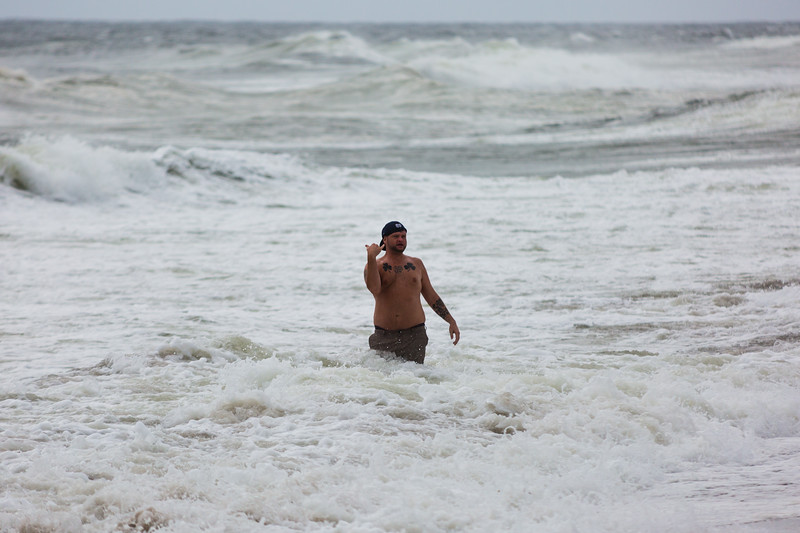 A lone swimmer braves the surf  churned up by Hurricane Matthew in Delray Beach on Thursday, October 6, 2016. (Joseph Forzano / The Palm Beach Post)