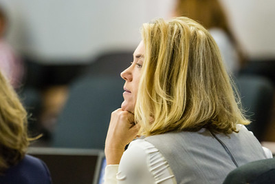 Former Assistant State Attorney Angela Miller listens to the testimony of  Palm Beach County State Attorney Dave Aronberg on Friday, October 28, 2016, during a trial where Aronberg is accused of improperly firing  Miller while she was undergoing cancer treatment.