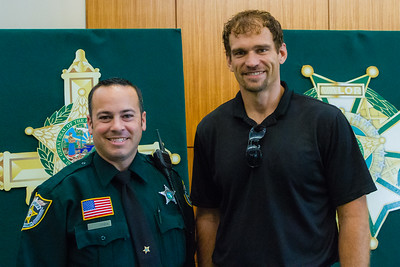 PBSO deputy Casey Lussier and Jason Shephard of Wellington. Shephard received a Good Samaritan award from the Palm Beach County Sheriff's Office at the Palm Beach County Convention Center in West Palm Beach on Thursday, November 3, 2016. Shephard intervened when PBSO deputy Casey Lussier had trouble restraining an agitated suspect at a gas station Wellington. Shephard threw himself on the suspect and with the help of the deputy restrained the suspect until backup arrived. (Joseph Forzano / The Palm Beach Post)