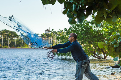 While President Elect Donald Trump vacations at Mar-a-Lago, Guimel Perez of West Palm Beach casts a net in the hopes of catching mullet for fishing bait on the beach of Bingham Island on Thursday, December 29, 2016. (Joseph Forzano / Daily News)
