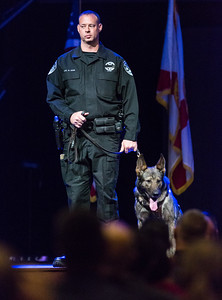 Boynton Beach Police K9 Officer Mark Sohn stands with Daxxx during Boynton Beach Police  K9 Officer Joseph Crowder's memorial at Christ Fellowship Church in Boynton Beach on Thursday, January 5, 2016. Crowder  died suddenly while jogging in December 2016.   Daxxx was Crowder's K9 partner. (Joseph Forzano / The Palm Beach Post)
