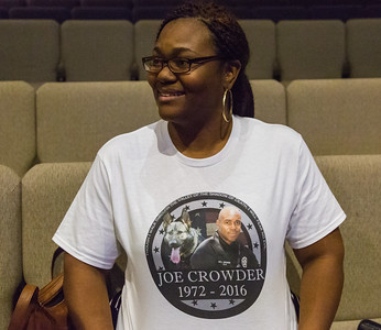 Amanda Jordan of Lake Worth  wears a Joe Crowder memorial T-Shirt at Christ Fellowship Church in Boynton Beach on Thursday, January 5, 2016 during a memorial of Boynton Beach Police K9 Officer Joseph Crowder. Crowder  died suddenly while jogging in December 2016. Jordan is Crowder's niece.  (Joseph Forzano / The Palm Beach Post)