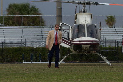 Nick Saban, head coach of the Alabama Crimson Tide makes his way off the field after arriving by helicopter at Palm Beach Lakes Community High School on Friday, January 27, 2017. Saban flew in to talk to Rams coaches about potential recruits. (Joseph Forzano / The Palm Beach Post)