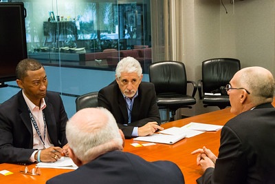 Palm Beach Post Editorial Board members Rick Christie (left) and Howard Goodman speak with Mike Reininger, Executive Director of Florida East Coast Industries and Dennis Grady, President and CEO of the Chamber of Commerce of the Palm Beaches  on Thursday, March 23, 2017 in West Palm Beach Florida. (Joseph Forzano / The Palm Beach Post)