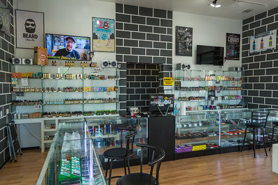 The interior of E Vapor Squad in Palm Beach Gardens on Friday, March 24, 2016. E-juices and battery mods of varying prices adorn the shelves and display cases. (Joseph Forzano / The Palm Beach Post)