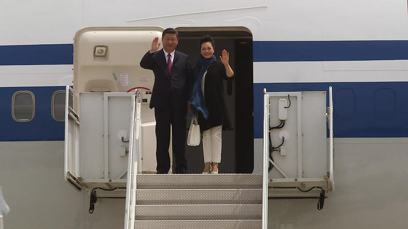 Xi Jinping, China's President and wife Peng Liyuan arrive at Palm Beach International Airport in West Palm Beach, Florida, on Thursday, April 6, 2017. President Trump will host Xi in their first face-to-face encounter, meeting today at the Mar-a-Lago Club.(Joseph Forzano / The Palm Beach Post)