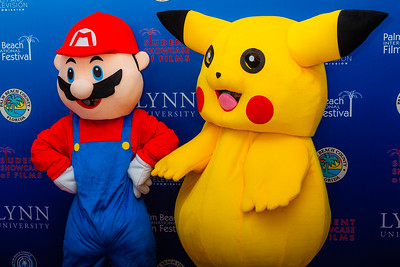 Video game characters Super Mario and Pikachu stand together for a photo on the red carpet of the 2018 Palm Beach Film Festival Student Showcase of Film. The festival was held at the Wold Theater on the Lynn University Campus in Boca Raton on Friday, March 6, 2018.  (Joseph Forzano / The Palm Beach Post)