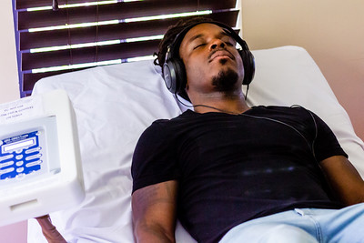 Palm Beach Post reporter Wilkine Brutus relaxes in a Purewave bed at the Hippocrates Health Institute on Wednesday, June 27, 2018. The Purewave uses sound and stimulation to relax an overactive mind. (Joseph Forzano / The Palm Beach Post)
