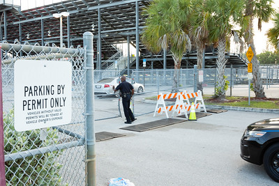 A Palm Beach High School Police Office opens the gates to the Palm Beach Central High School parking lot so owners can retrieve their cars after the shooting on Friday night, August 17, 2018, during the football game between Palm Beach Central and Dwyer. Image captured on Saturday, August 18, 2018. (Joseph Forzano / The Palm Beach Post)