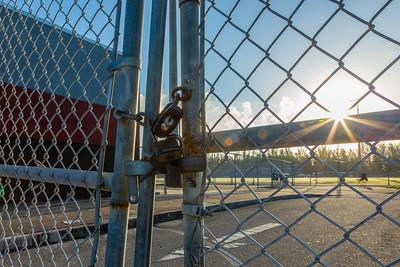 Padlocks are on the gates to the football stadium at Palm Beach Central High School after a shooting during a football game on Friday night, August 17, 2018. Photo captured on Saturday, August 18, 2018. (Joseph Forzano / The Palm Beach Post)