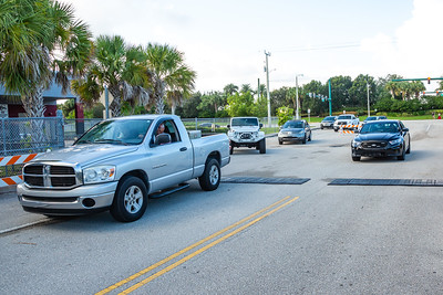 A queue of cars starts pulling through the opened gates to the Palm Beach Central High School parking lot so owners can retrieve their cars left overnight after a shooting during a football game between Palm Beach Central and Dwyer. Image captured on Saturday, August 18, 2018. (Joseph Forzano / The Palm Beach Post)