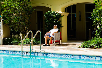 Richard Klein, 91, relaxes in the sun after completing 50 laps in the pool at Tradition at MorseLife in West Palm Beach on Wednesday, October 31, 2018. Klein, a former Olympian in track and field and tennis has been a resident at Tradition for a year and exercises in the pool every day.  [JOSEPH FORZANO/palmbeachpost.com]