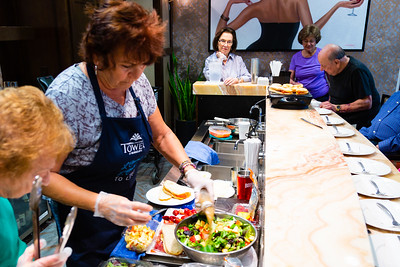 Debra Mazda  prepares a apple strawberry salad during a cooking demonstration at Tradition of MorseLife in West Palm Beach on Wednesday, October 31, 2018. [JOSEPH FORZANO/palmbeachpost.com]