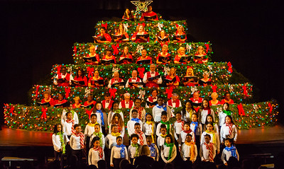 Members of the Living Christmas Tree Choir and the Young Singers of the Palm Beaches Choir in the Glades perform together during the final performance of the Living Christmas Tree at the Dolly Hand Cultural Arts Center in Belle Glade on Sunday, December 2, 2018. [JOSEPH FORZANO/palmbeachpost.com]