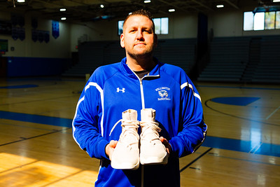 Wellington High School Basketball Coach Matt Colin holds a pair of the new Nike Fear of God 1 Light Bone sneakers, donated to the Wellington High School boys and girls basketball teams by  fashion designer Jerry Lorenzo on Wednesday, January 16, 2019 at Wellington High School, in Wellington, Florida. Lorenzo, founder of streetwear label Fear of God, donated the sneakers to the Wellington High School boys and girls basketball teams. Each pair costs $350.00. [JOSEPH FORZANO/palmbeachpost.com]