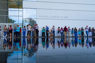 Members of the public wait on the Heyman Plaza for the Norton Museum of the Arts grand opening ceremonies to start on February 9, 2019.  [JOSEPH FORZANO/palmbeachpost.com]