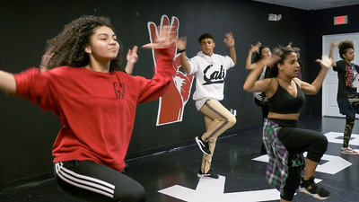 Yesenia Mendoza, Christian Pineiro, Nyssa Figueroa, Frances Bonilla and Sofia Casco learn new choreography from Jorge Dante Luna, better known as Flaco Luna, owner of Oganized Kaos Dance Academy in Lake Worth, on Tuesday, March 19, 2019. [JOSEPH FORZANO/palmbeachpost.com]