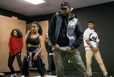 (From left to right: Yesenia Mendoza, Frances Bonilla, P.J. Giordano, Flaco Luna and Christian Pineiro) Jorge Dante Luna, better known as Flaco Luna (right), owner of Oganized Kaos Dance Academy in Lake Worth, teaches a group his students new choreography, on Tuesday, March 19, 2019. [JOSEPH FORZANO/palmbeachpost.com]