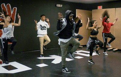 (From left to right Nyssa Figueroa, Christian Pineiro, Flaco Luna, P.J. Giordano, Frances Bonilla and Yesenia Mendoza) Jorge Dante Luna, better known as Flaco Luna (right), owner of Oganized Kaos Dance Academy in Lake Worth, teaches a group his students new choreography, on Tuesday, March 19, 2019. [JOSEPH FORZANO/palmbeachpost.com]