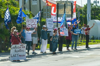 Supporters of President Trump stand along Southern Blvd., as the Presidential motorcadepasses by on Saturday, March 30, 2019. [JOSEPH FORZANO/palmbeachpost.com]