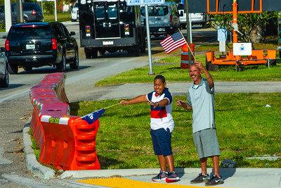 Supporters along Southern Boulevard greet President Donald J. Trump as his motorcade passes by on the way toward Trump International Golf Club in West Palm Beach on Sunday, March 31, 2019. [JOSEPH FORZANO/palmbeachpost.com]