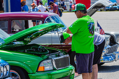 Car enthusiasts getting a closer look at one of the trucks on display at Palm Beach International Raceway on Saturday, May 25, 2019.[JOSEPH FORZANO/palmbeachpost.com]