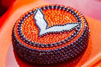 Swarovski crystal decorate a cap on the engine of a 2015 Chevrolet Corvette Stingray, owned by Jeff Brandt of Royal Palm Beach at the Super Chevy Show at Palm Beach International Raceway in Jupiter, on Saturday, May 25, 2019. Brandt said there are over 84,000 Swarovski crystals decorating the Corvette. [JOSEPH FORZANO/palmbeachpost.com]
