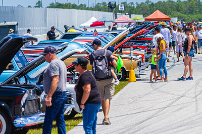 Car enthusiasts admiring a variety of Chevy's at Palm Beach International Raceway on Saturday, May 25, 2019.[JOSEPH FORZANO/palmbeachpost.com]