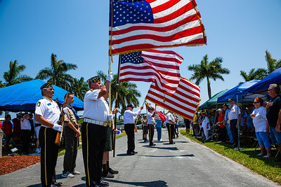 Members of the Boynton Beach Veterans present colors during the Memorial Day Observance at Boynton Beach Memorial Park on Sunday, May 26, 2019. [JOSEPH FORZANO/palmbeachpost.com]