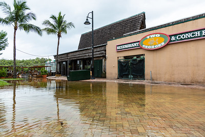 Two George's parking lot starts to flood ahead of the King Tide on Tuesday, September 3, 2019, as Hurricane Dorian begins to slide up north, just off Florida's east coast. [JOSEPH FORZANO/palmbeachpost.com]