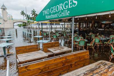 The dining area at Two George's in Boynton Beach starts to flood on Tuesday, September 3, 2019. The flooding is a result of rains from Hurricane Dorian and the King Tide. [JOSEPH FORZANO/palmbeachpost.com]