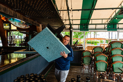 Kevin Kudlinski, the district manager of Two George's in Boynton Beach, moves a table back to it's position on Tuesday, September 3, 2019, as Hurricane Dorian begins to slide up north, just off Florida's east coast. Two George's is expected to open at 3 p.m. today. [JOSEPH FORZANO/palmbeachpost.com]