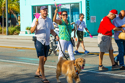 Aaron Wormus of West Palm Beach with his dog Jackson and Christina Lambert, District 5 Commissioner of West Palm Beach, march in the 1st Annual Latin Quarter WPB 2019 Hispanic Heritage Month Parade, on Saturday, October 5, 2019. [JOSEPH FORZANO/palmbeachpost.com]