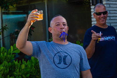 A spectator raises a glass to salute the marchers in the 1st Annual Latin Quarter WPB 2019 Hispanic Heritage Month Parade, on Saturday, October 5, 2019. [JOSEPH FORZANO/palmbeachpost.com]