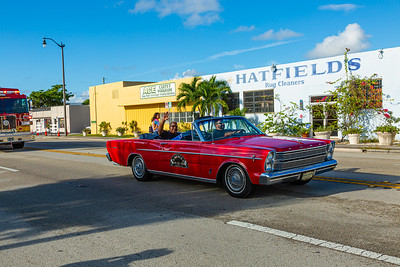 Grand Marshall and West Palm Beach Mayor rides in a 1965 Ford Galaxie from Ragtop Motorcars and waves to spectators on Dixie Highway during the 1st Annual Latin Quarter WPB 2019 Hispanic Heritage Month Parade, on Saturday, October 5, 2019. [JOSEPH FORZANO/palmbeachpost.com]