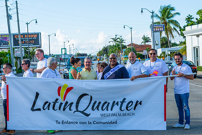 West Palm Beach Mayor Keith James stands with members of the parade procession before the start of the 1st Annual Latin Quarter WPB 2019 Hispanic Heritage Month Parade, on Saturday, October 5, 2019. Mayor James is the Grand Marshall of the parade. [JOSEPH FORZANO/palmbeachpost.com]