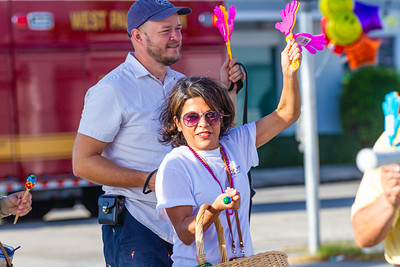 Dina Rubin and Aaron Wormus arrive at St. Juliana's Catholic Church in West Palm Beach at the end of the 1st Annual Latin Quarter WPB 2019 Hispanic Heritage Month Parade, on Saturday, October 5, 2019. [JOSEPH FORZANO/palmbeachpost.com]