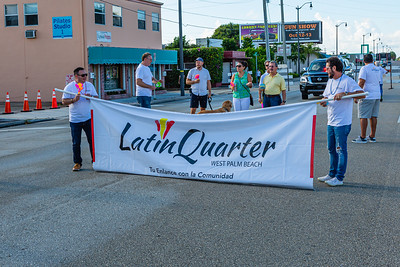 Livan Rodrigue from Toronto, Canada and Issy Gonzalez from Toronto, Canada, hold the Latin Quarter banner before the start of the 1st Annual Latin Quarter WPB 2019 Hispanic Heritage Month Parade. [JOSEPH FORZANO/palmbeachpost.com]