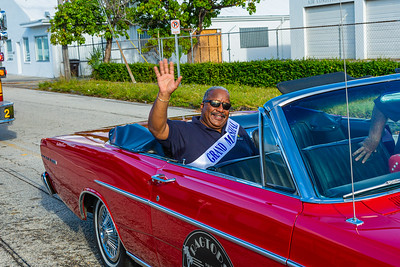 Grand Marshall and West Palm Beach Mayor Keith James sits in the 1965 Ford Galaxie 500 from Ragtop Motorcars at the start of the 1st Annual Latin Quarter WPB 2019 Hispanic Heritage Month Parade, on Saturday, October 5, 2019. [JOSEPH FORZANO/palmbeachpost.com]