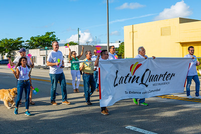Members of the parade procession walk north along Dixie Highway toward St. Juliana's Catholic Church during the 1st Annual Latin Quarter WPB 2019 Hispanic Heritage Month Parade, on Saturday, October 5, 2019. [JOSEPH FORZANO/palmbeachpost.com]