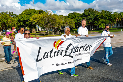 The members of the parade make the turn into St. Juliana's Catholic Church during the 1st Annual Latin Quarter WPB 2019 Hispanic Heritage Month Parade, on Saturday, October 5, 2019. [JOSEPH FORZANO/palmbeachpost.com]