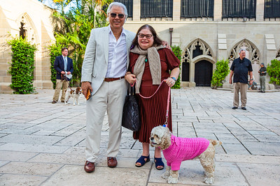 Alex Rosal, Karen Kossman and Bella from West Palm Beach (all wearing Ralph Lauren) await the start of the Blessing of the Animals service at The Church of Bethesda-by-the-Sea in Palm Beach on Sunday, October 6, 2019. [JOSEPH FORZANO/palmbeachpost.com]